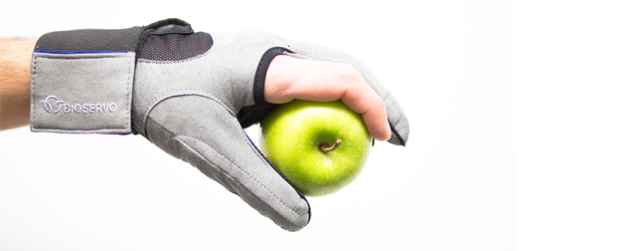 Glove with sensors and holding an apple
